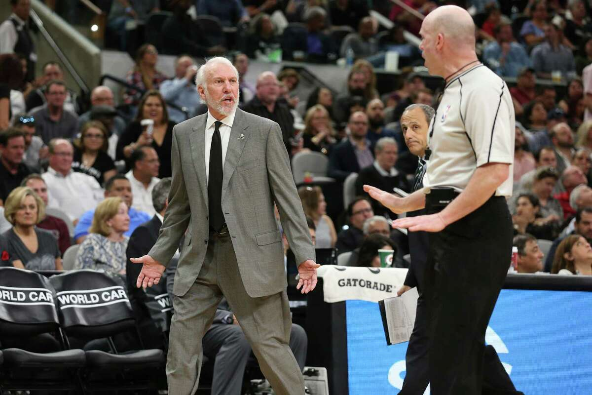 San Antonio Spurs' head coach Gregg Popovich challenges a call with official Gary Zielinski during the first half at the AT&T Center, Wednesday, March 23, 2016. Second before, Popovich was hit with a technical foul after arguing a possession call.