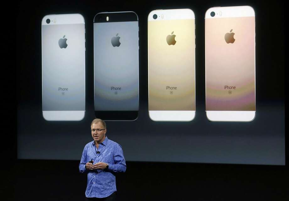 In this Monday, March 21, 2016, file photo, Greg Joswiak, vice president of iOS, iPad and iPhone product marketing, announces the new iPhone SE at Apple headquarters in Cupertino. Photo: Marcio Jose Sanchez, AP