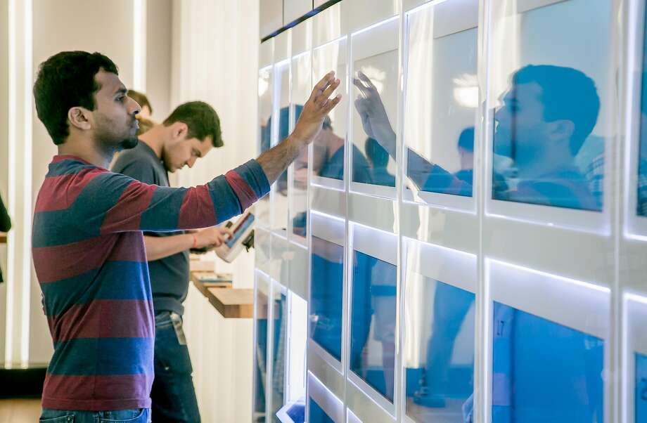 A customer taps a cubby to get his bowl at Eatsa automated restaurant in S.F. Photo: John Storey, Special To The Chronicle
