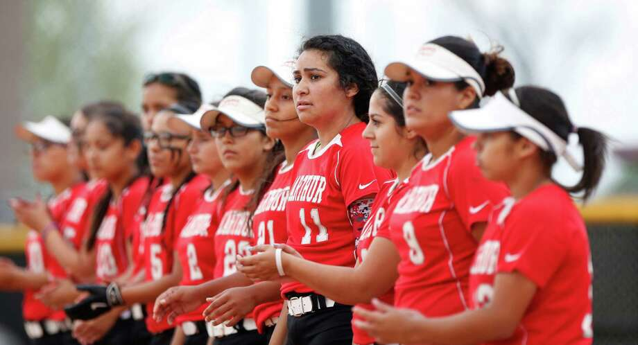 MacArthur catcher Vanessa Garcia and teammates line up for player introductions before the start of a softball game between MacArthur and Aldine High Schools, Tuesday, March 22, 2016.  MacArthur is having its best season in recent memory (14-3-1), which included jumping in to the state rankings last week. A core of the team has played together since little league. Photo: Karen Warren, Houston Chronicle / © 2016  Houston Chronicle
