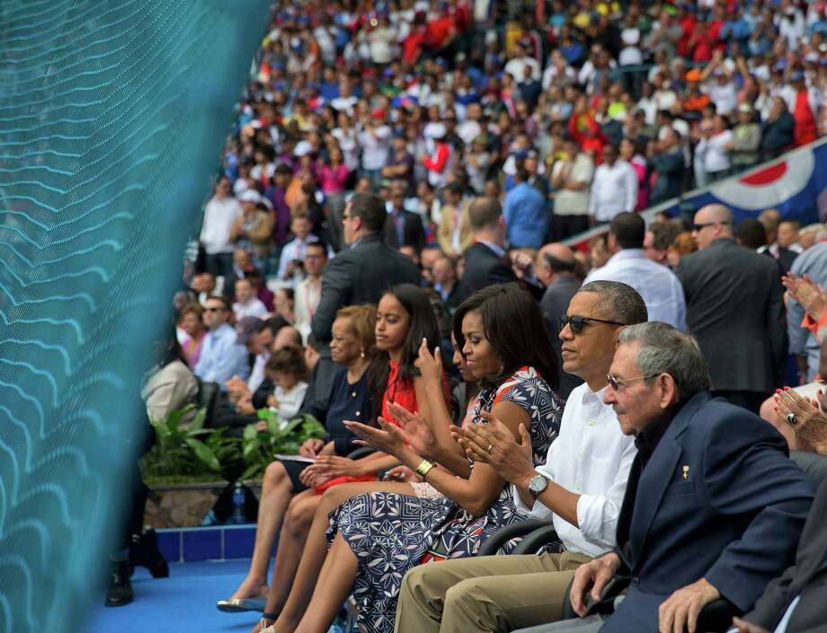 President Barack Obama, with his family, and Cuban President Raul Castro attend a exhibition baseball game between the Tampa Bay Rays and the Cuban National team at the Estadio Latinoamericano, Tuesday, March 22, 2016, in Havana, Cuba. (AP Photo/Pablo Martinez Monsivais) Photo: Pablo Martinez Monsivais, STF / AP
