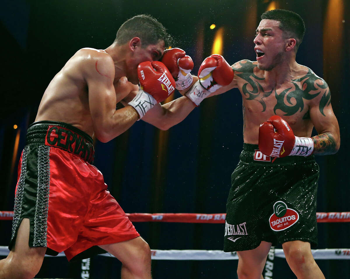 Luis Cervantes (left) and Ivan Najera exchange punches during their lightweight bout on Nov. 15, 2014 at the Alamodome.