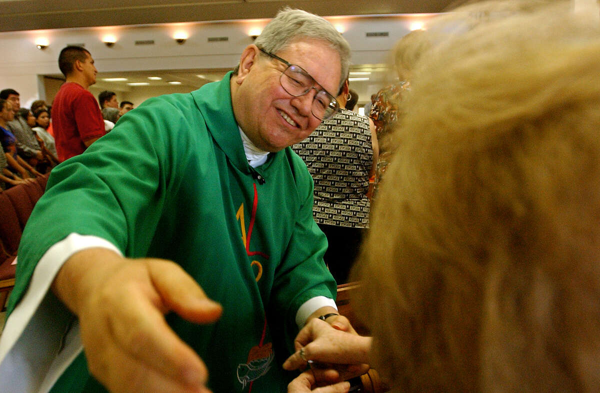 Father Virgilio Elizondo walked out into the congregation to offer the sign of peace during a Sunday Mass at St Rose of Lima parish in 2002.