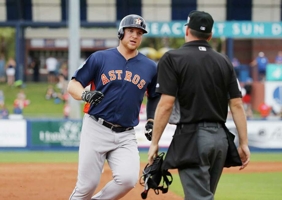 Houston Astros' A.J. Reed rounds third base while looking to the umpire after New York Mets' left fielder Yoenis Cespedes pleads for a ground rule double during the second inning of an exhibition spring training baseball game, Thursday, March 24, 2016, in Port St. Lucie, Fla. Reed was credited with an inside-the-park home run (AP Photo/Brynn Anderson) Photo: Getty Images
