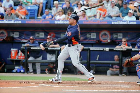Houston Astros' A.J. Reed hits an in-the-park home run off New York Mets' starting pitcher Matt Harvey, during the second inning of an exhibition spring training baseball game, Thursday, March 24, 2016, in Port St. Lucie, Fla. (AP Photo/Brynn Anderson)