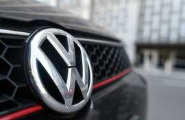 """A Volkswagen vehicle is seen parked in front of the US District Court in San Francisco, California after a court proceeding regarding the Volkswagen """"Clean Diesel"""" case on March 24, 2016. US judge on Thursday gave Volkswagen until April 21 to come up with a plan to fix some 600,000 cars spewing illegal levels of pollutants due to emissions-cheating software. """"This issue of what is to be done with these cars must be done by that date,"""" US District Court Judge Charles Breyer told attorneys of the German automaker during a status hearing.  / AFP PHOTO / Josh EdelsonJOSH EDELSON/AFP/Getty Images"""