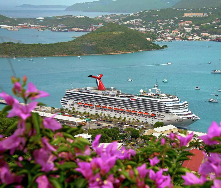 The Carnival Freedom is docked in St. Thomas, U.S.V.I, in June 2014. The 952-foot-long liner accommodates more than 3,000 guests and  will sail from Galveston to Nassau July 6 where country star Trace Adkins will perform onboard, as part of the Carnival LIVE entertainment series. Photo: Andy Newman /Carnival Cruise Lines / Carnival Cruise Lines