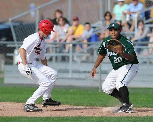 First baseman, Will Marr, # 20, of Norwalk High School, right, takes the throw during an unsuccessful pick-off attempt as Greenwich High School's Casey Gaynor, # 10 just gets back to the bag, April 7, 2010. Photo: Bob Luckey / Greenwich Time
