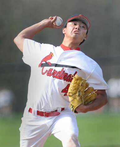 Greenwich High School  pitcher, Yuta Okazaki, throws hard during game against Norwalk High School at GHS Wednesday afternoon, April 7, 2010.  Okazaki pitched six innings and held Norwalk to just one run and was credited with the win in a 4-1 GHS victory over Norwalk High School. Photo: Bob Luckey / Greenwich Time