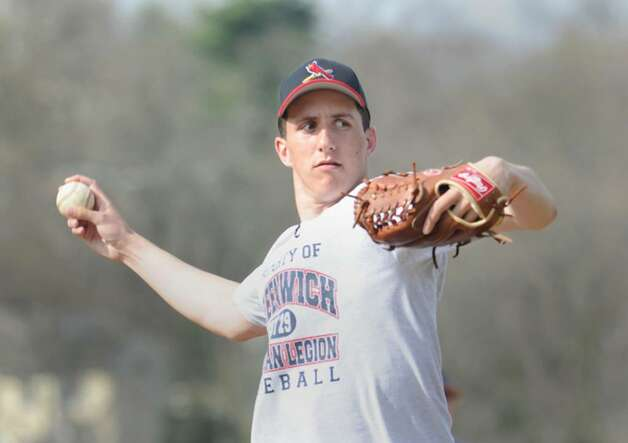 GHS pitcher, Ryan Carr, throws during practice at GHS, April 6, 2010. Photo: Bob Luckey / Greenwich Time