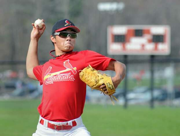 Greenwich High School pitcher, Yuta Okazaki, in action during practice at the GHS, April 6, 2010. Photo: Bob Luckey / Greenwich Time