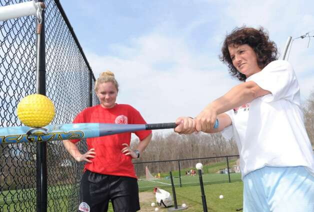 GHS girls softball coach, Mary Beth Fratello, right, works with her player, Tina Byrne, a senior, during practice at the school, April 6, 2010. Photo: Bob Luckey / Greenwich Time