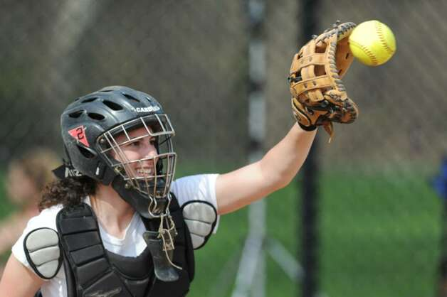 Greenwich High School girls softball catcher, Alex LoGrasso, catches the high and hard fastball thrown by her teammate Marie-Claire Bousquette, during practice at GHS, April 6, 2010. Photo: Bob Luckey / Greenwich Time