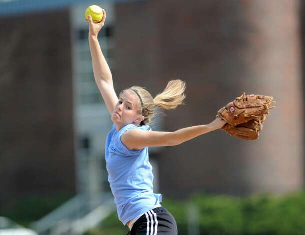 Greenwich High School softball pitcher, Marie-Claire Bousquette, throws during practice at the school, April 6, 2010. Photo: Bob Luckey / Greenwich Time