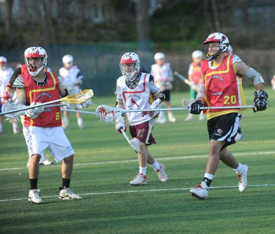 Greenwich High School varsity lacrosse co-captain, P. J. Schwabe, right, during a practice on the Greenwich High School athletic fields, on Monday, April 5, 2010. Photo: Helen Neafsey / Greenwich Time