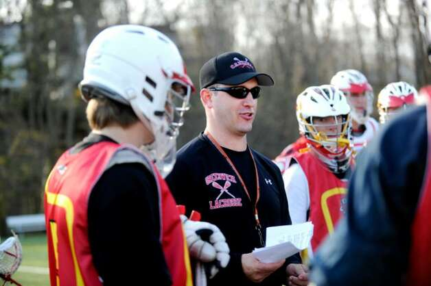 Greenwich High School boys lacrosse coach, Scott Bulkley, speaks to the varsity team during a practice, on Monday, April 5, 2010. Photo: Helen Neafsey / Greenwich Time