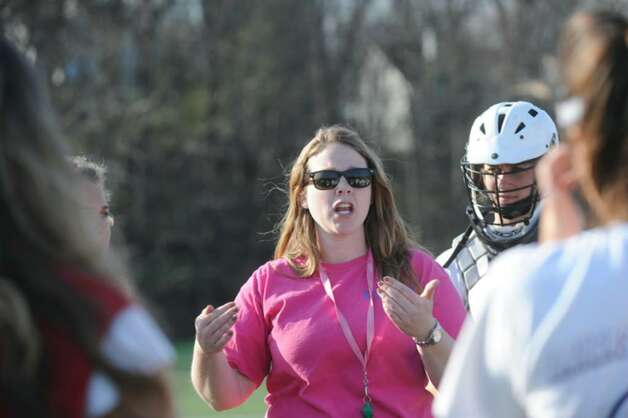 Greenwich High School girls lacrosse coach Caitlin Keane, speaks to the girls varsity team at the Greenwich High School's athletic fields, on Monday, April 5, 2010. Photo: Helen Neafsey / Greenwich Time