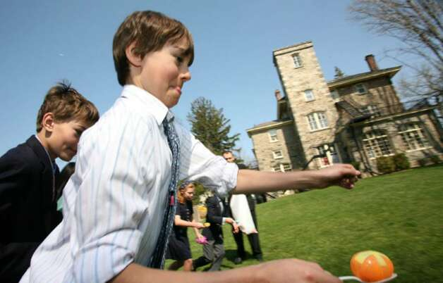 Andreas Kern tests his skill at an egg carrying contest that took place for children at the Second Congregational Church Easter Sunday. Photo: David Ames, David Ames/For Greenwich Time / Greenwich Time
