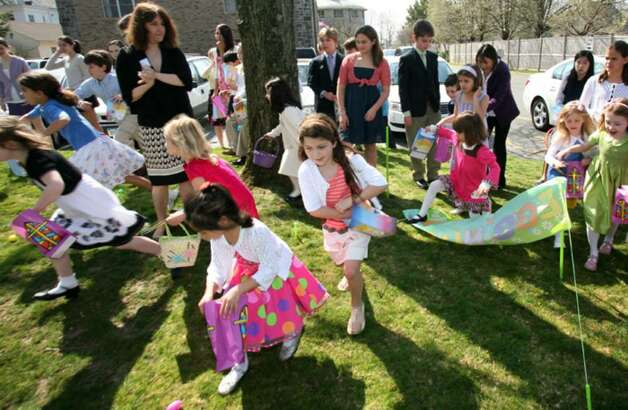 Children of the Second Congregational Church scramble for easter eggs at the start of Sunday mornings easter egg hunt held at the church. Photo: David Ames, David Ames/For Greenwich Time / Greenwich Time