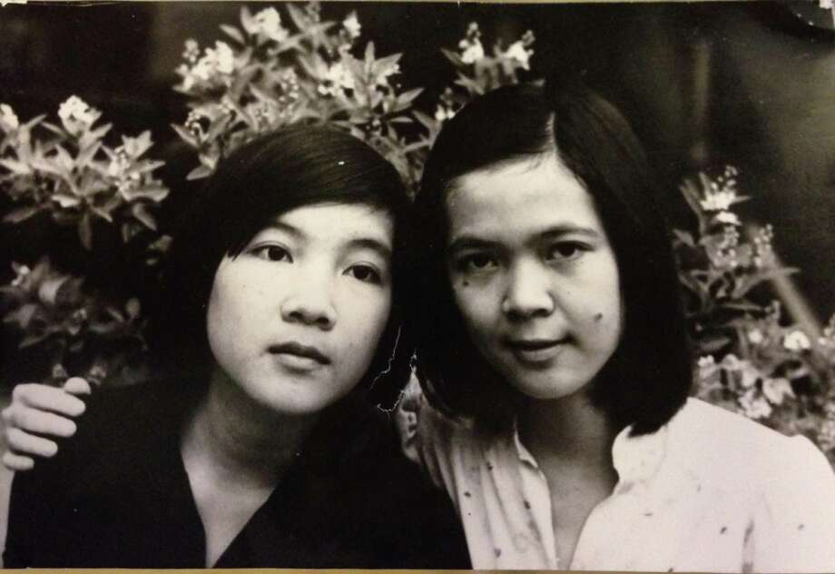 A 14-year-old Anhlan Nguyen, right, with her sister Kieu when they still lived in Vietnam. Photo: Courtesy Photo