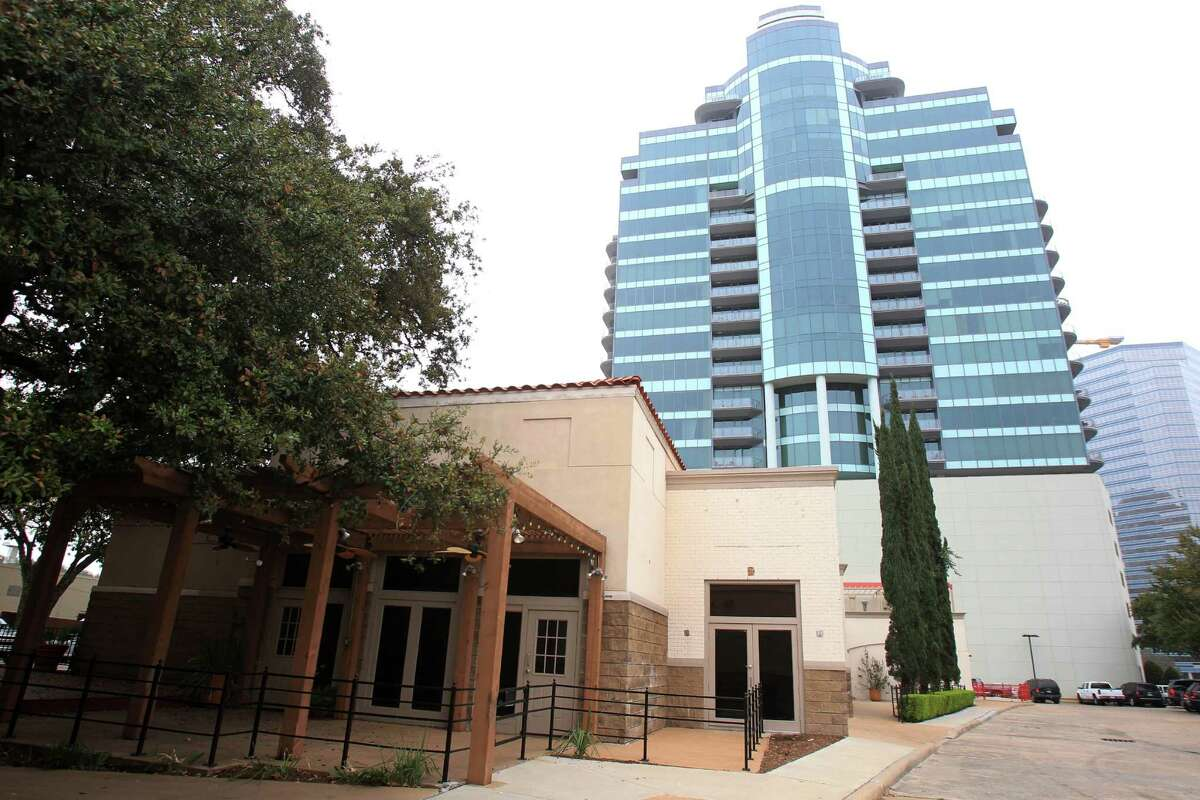 The owner of Courtyard at Post Oak, shopping center at the corner of Post Oak Blvd. and San Felipe with the Cosmopolitan in the background on Feb. 25, 2014, in Houston. ( Mayra Beltran / Houston Chronicle )