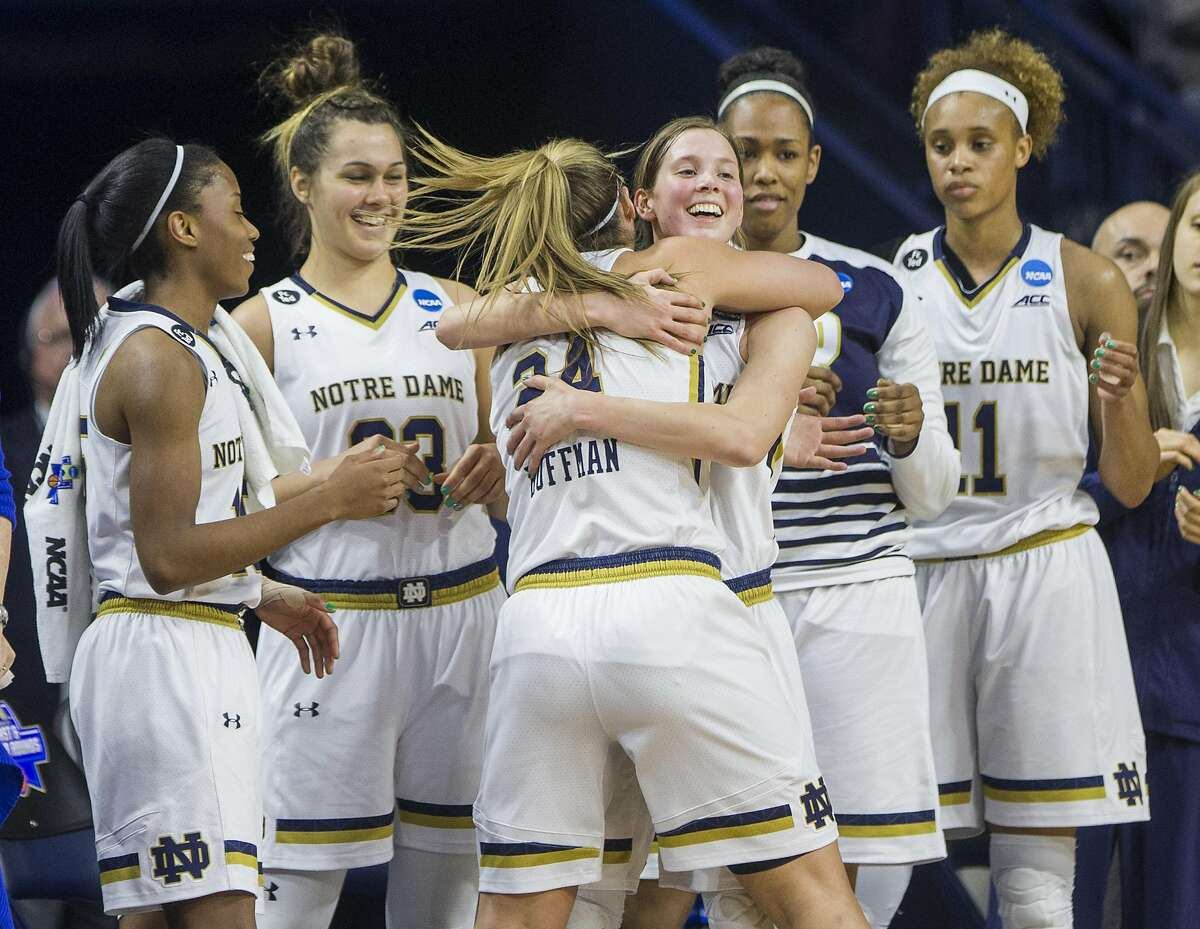 Notre Dame�s Hannah Huffman (24) hugs teammate Madison Cable after coming off the court for the final time during the second half of Notre Dame�s 87-70 win against Indiana in a second-round women's college basketball game in the NCAA Tournament, Monday, March 21, 2016, in South Bend, Ind. (AP Photo/Robert Franklin)