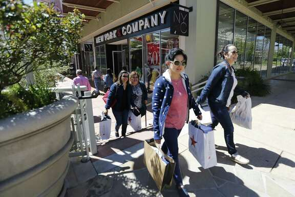Monica Villarreal (from right), Flor Villarreal, Diana Rodriguez and Belinda Villarreal - all from Laredo - stroll past a store front at the Shops at La Cantera on Thursday, Mar. 24, 2016. About 60.5 percent of Texas retail executives told the Federal Reserve Bank of Dallas in June that their businesses were negatively impacted in some way by lower gas prices.
