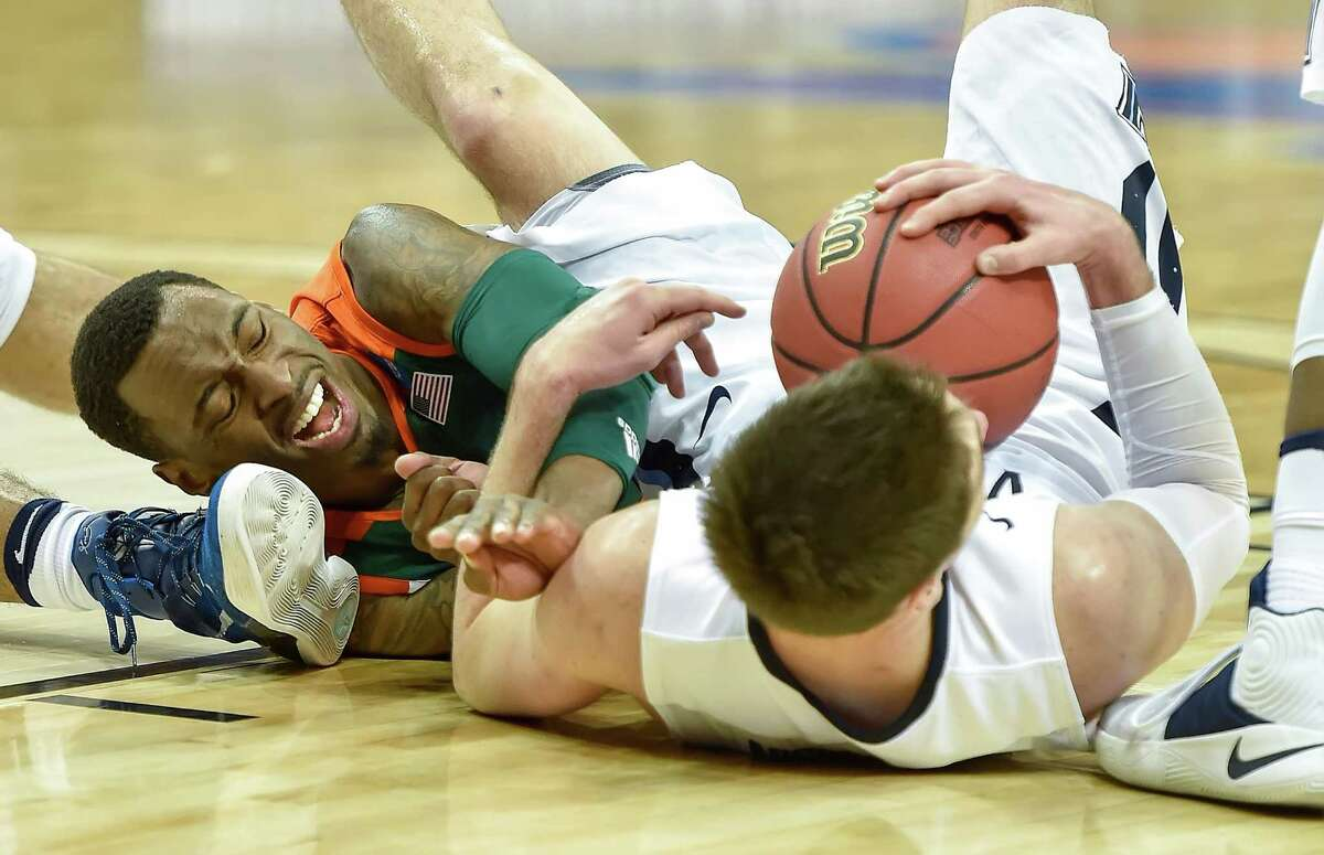 Miami's Sheldon McClellan, left, scrambles for a loose ball with Villanova's Ryan Arcidiacono in the first half during a Sweet 16 matchup in the NCAA Tournament's South region at the KFC Yum! Center in Louisville, Ky., on Thursday, March 24, 2016.