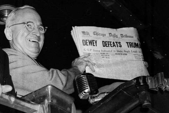 "FILE--U.S. President Harry S. Truman holds up an Election Day edition of the Chicago Daily Tribune, which, based on early results, mistakenly announced ""Dewey Defeats Truman"" in this Nov. 4, 1948 file photo. Erroneous headlines proclaiming Gov. George W. Bush's victory were printed by newspapers around the country Wednesday morning, Nov. 8, 2000, before the U.S. presidential election was declared undecided pending a recount of all votes in Florida. (AP Photo/Byron Rollins, File)"