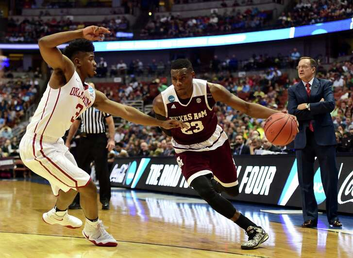 ANAHEIM, CA - MARCH 24:  Danuel House #23 of the Texas A&M Aggies drives on Christian James #3 of the Oklahoma Sooners in the first half in the 2016 NCAA Men's Basketball Tournament West Regional at the Honda Center on March 24, 2016 in Anaheim, California.