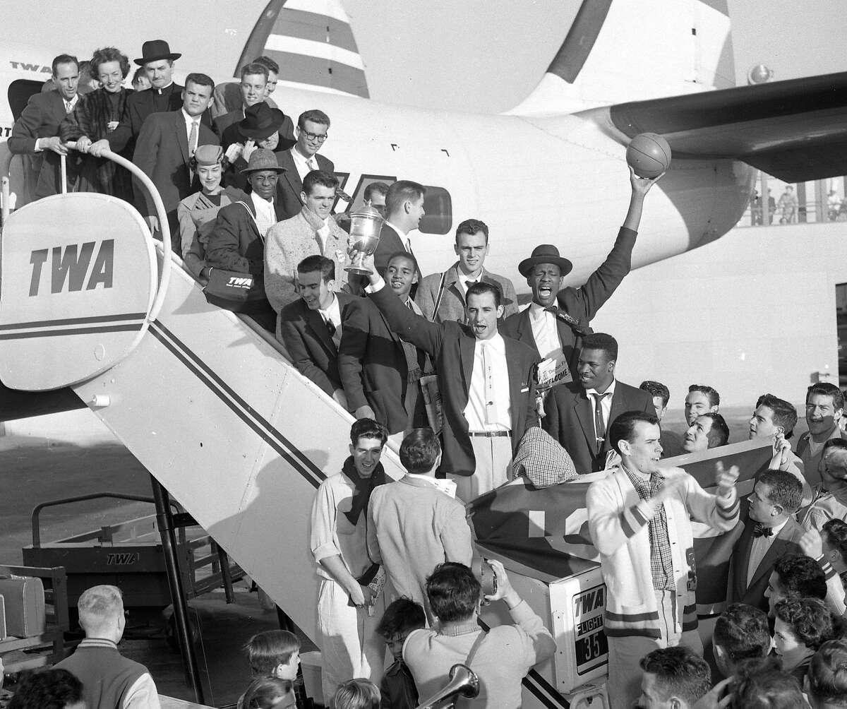 USF Dons at the airport as they return home from Kansas City March 25, 1955, after winning NCAA championship in basketball title
