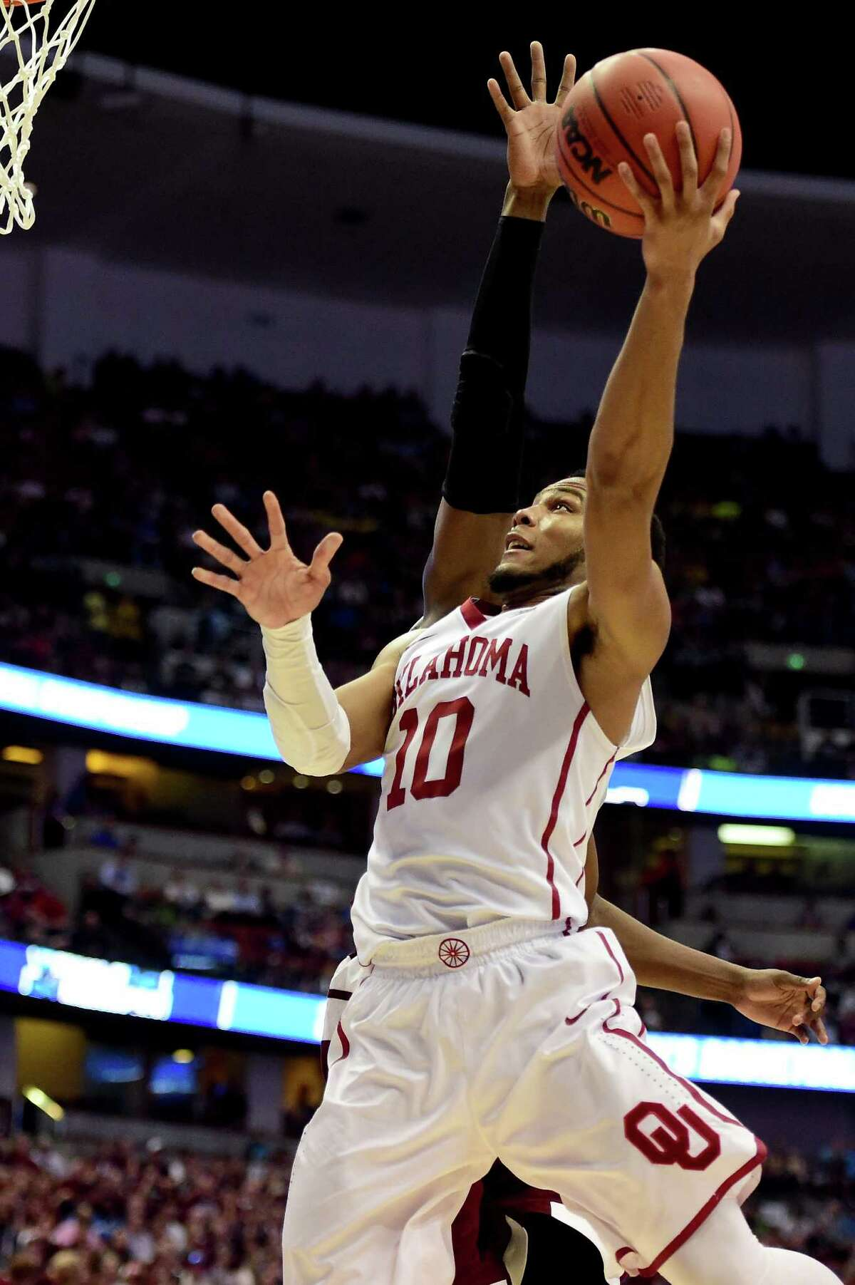 ANAHEIM, CA - MARCH 24: Jordan Woodard #10 of the Oklahoma Sooners lays the ball up against the Texas A&M Aggies in the second half in the 2016 NCAA Men's Basketball Tournament West Regional at the Honda Center on March 24, 2016 in Anaheim, California.