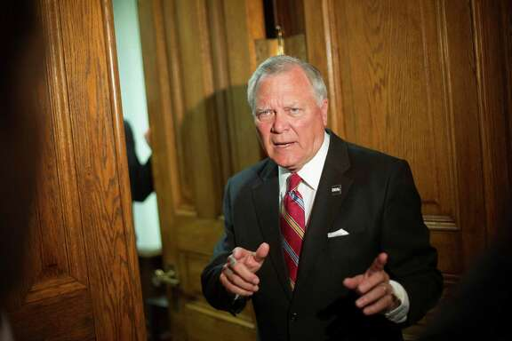 Georgia Gov. Nathan Deal tells members of the media he'll return in a moment to answer questions as heads into his office after a news event for an economic development announcement at the State Capitol, Monday, Nov. 3, 2014, in Atlanta. (AP Photo/David Goldman) ORG XMIT: GADG102
