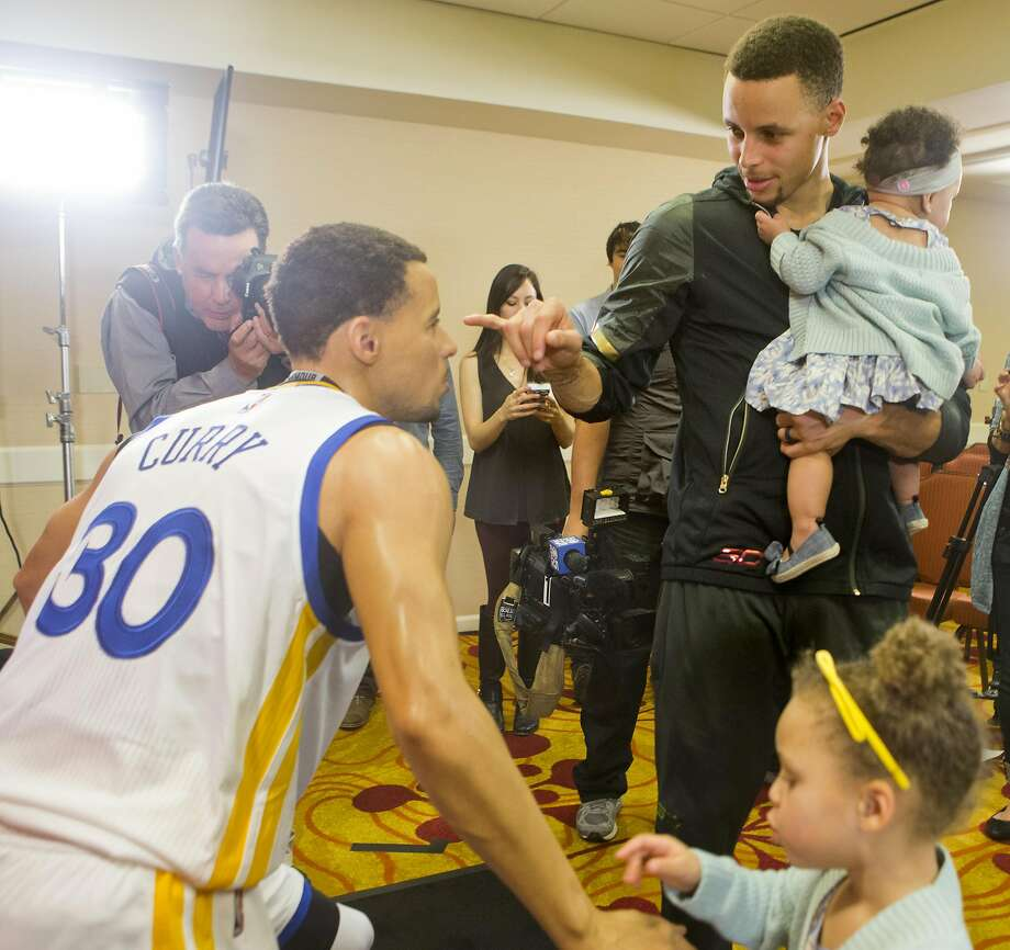 Warriors guard Stephen Curry is considered a model father by Parents magazine. The genuine article (right) checks out a wax replica with his children on March 24. Photo: Beck Diefenbach, Getty Images For Madame Tussauds