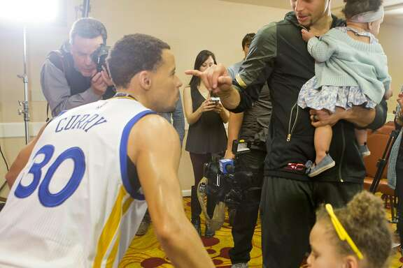 OAKLAND, CA - MARCH 24:  Golden State Warriors' Stephen Curry, with his daughters Riley and Ryan, inspects his wax figure made by Madame Tussauds San Francisco located on Fisherman's Warf on March 24, 2016 in Oakland, California.  (Photo by Beck Diefenbach/Getty Images for Madame Tussauds San Francisco)