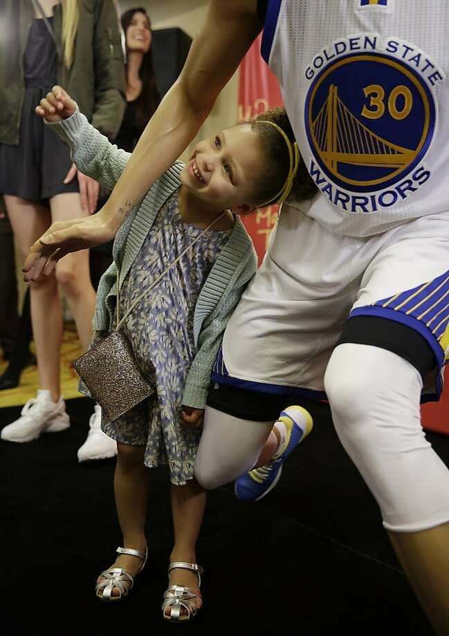 Riley Curry poses under a wax figure of her father, Golden State Warriors guard Stephen Curry, after its unveiling Thursday, March 24, 2016, in Oakland, Calif. The figure of the NBA MVP will go on display at Madame Tussauds wax museum at Fisherman's Wharf in San Francisco. (AP Photo/Eric Risberg) Photo: Eric Risberg, AP