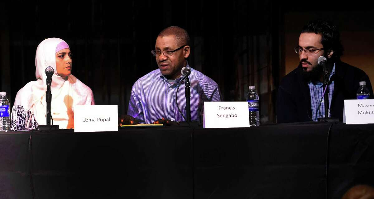 Francis Sengaboo, center, speaks during ongoing events in conjunction with the A City of Immigrants celebration WAMC Northeast Public Radio and the Times Union partnered on a live panel at The Linda, WAMC's Performing Arts Studio on Thursday, March 24, 2016, in Albany, N.Y. Panelists in attendence were; Alan Chartock, WAMC; Paul Grondahl, Albany Times Union; Uzma Popal, Pakistani immigrant; Francis Sengabo, a Twandan refugee with Refugees and Immigrants Support Services of Emmaus(RISSE) and Maseeh Mukhtar, immigrant and Ph.D student in nanotechnology at SUNY Polytechnic. (Skip Dickstein/Times Union)