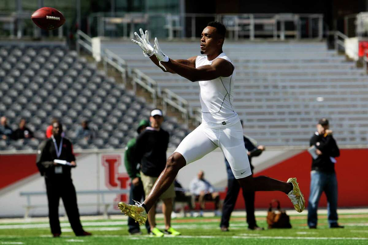 Cornerback William Jackson III runs a drill during the University of Houston's pro day Thursday with representatives from 31 NFL teams on hand.