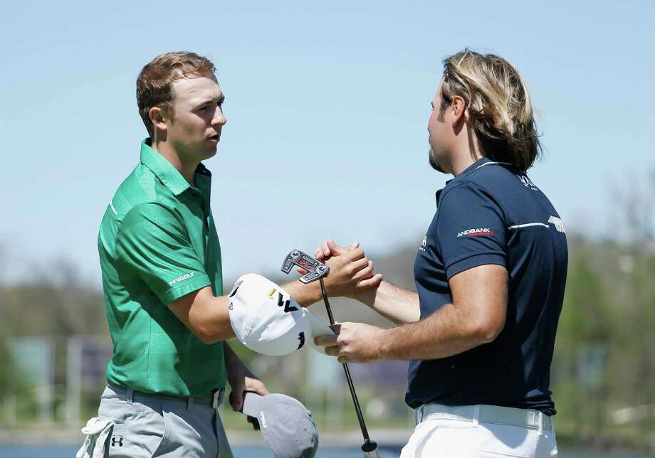 France's Victor Dubuisson, right, congratulates Jordan Spieth on the 14th green after Spieth closed out Dubuisson 5 and 4. Photo: Christian Petersen, Staff / 2016 Getty Images