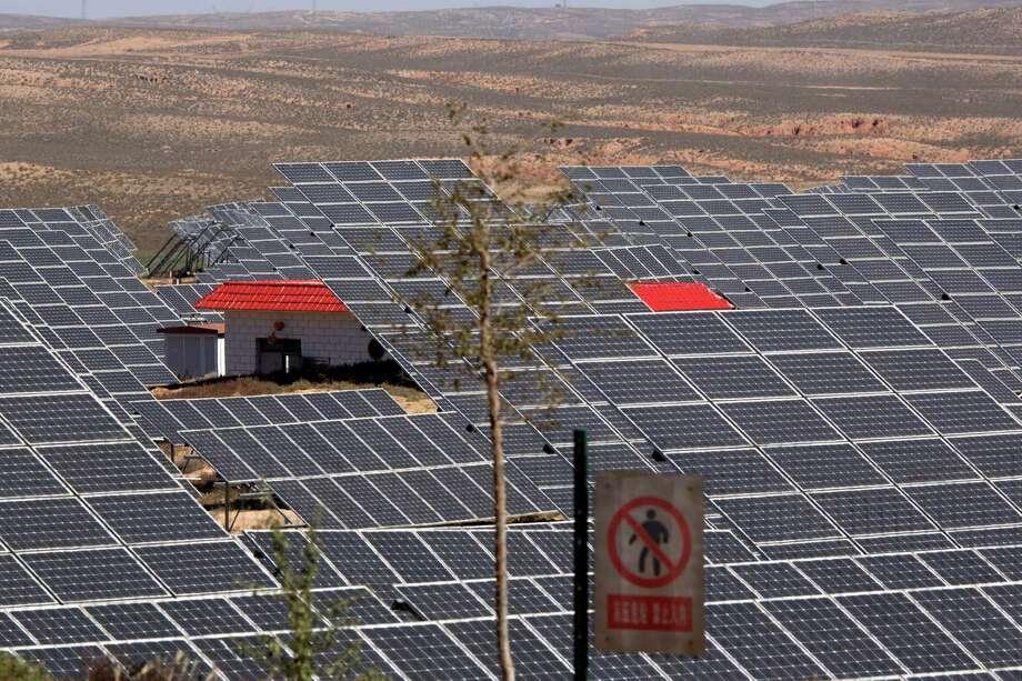An array of solar panels captures sunlight in northwestern China's Ningxia Hui autonomous region. Photo: Ng Han Guan, STF / AP