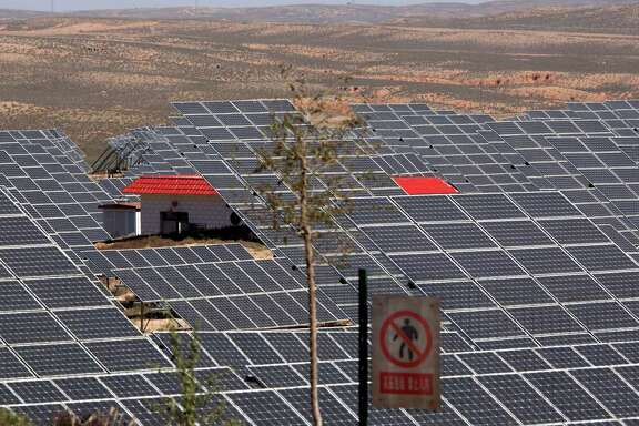 An array of solar panels captures sunlight in northwestern China's Ningxia Hui autonomous region.