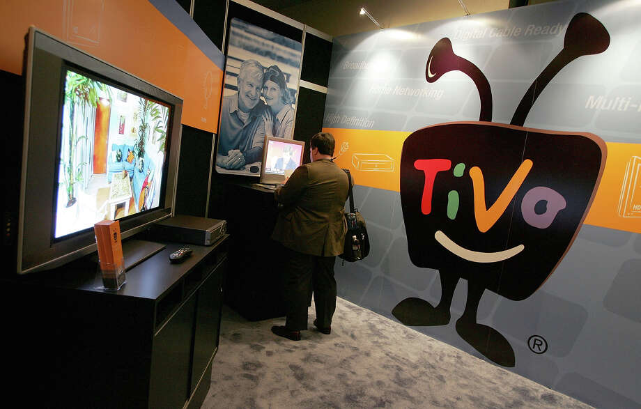 LAS VEGAS - JANUARY 6: A man looks at a Tivo display at the 2005 Consumer Electronics Show January 6, 2005 in Las Vegas, Nevada. The 1.5 million square foot electornic gadget show begins on Thursday and runs through Sunday and is expected to attract over 120,000 attendees.  (Photo by Justin Sullivan/Getty Images) Photo: Justin Sullivan, Staff / 2005 Getty Images