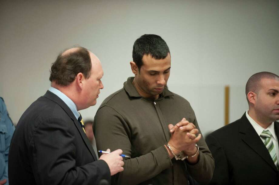 Defense attorney Daniel Ford talking to his client Alphah East, then a probation officer, during a bail hearing in Norwalk Connectiuct in January 2010 after he was charged with bribe taking. Photo: Douglas Healey / GT / Stamford Advocate Freelance