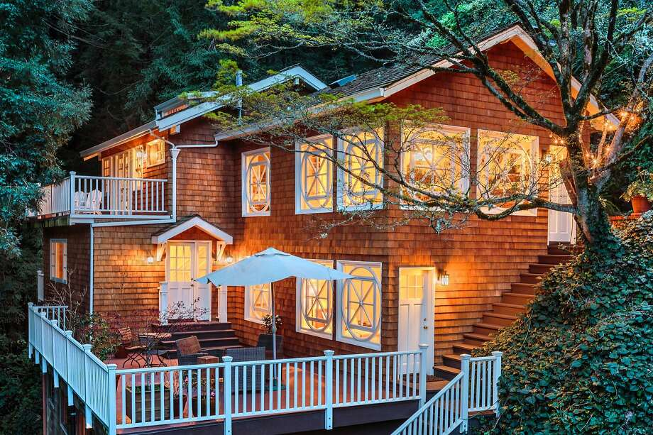 This twilight picture showcases decks off the lower level's master suite and the top floor living room. Photo: RobJPhotos.com
