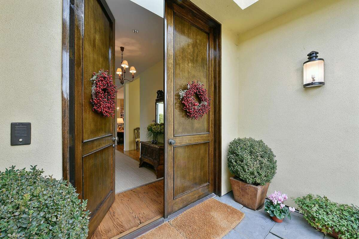 Dual entry doors provide a grand entrance from the enclosed porch.