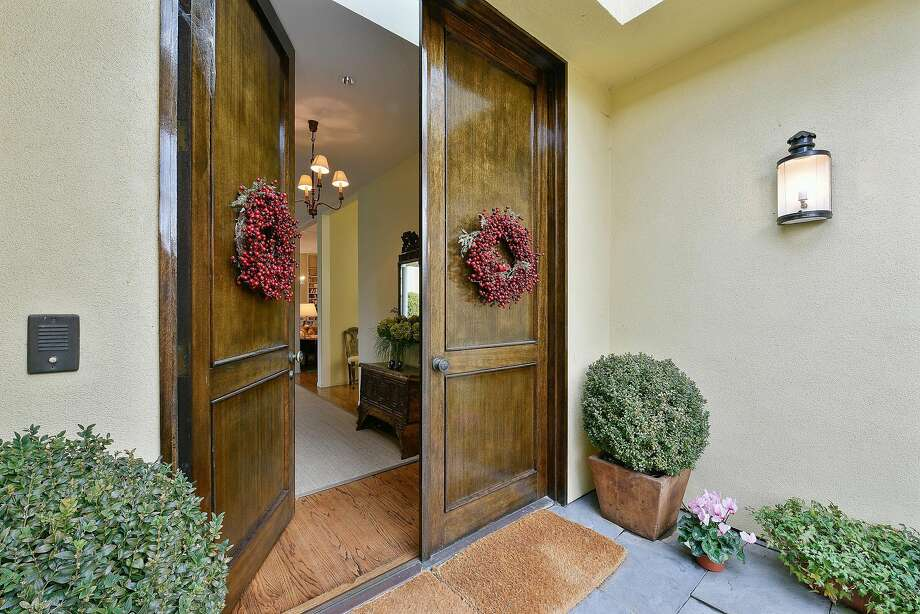 Dual entry doors provide a grand entrance from the enclosed porch.  Photo: Sean Nolan