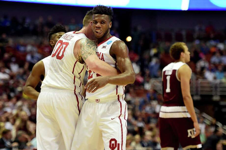 OU's Ryan Spangler, left, congratulates Buddy Hield, who had for him a modest total of 17 points but received plenty of help from his friends. Photo: Harry How, Staff / 2016 Getty Images