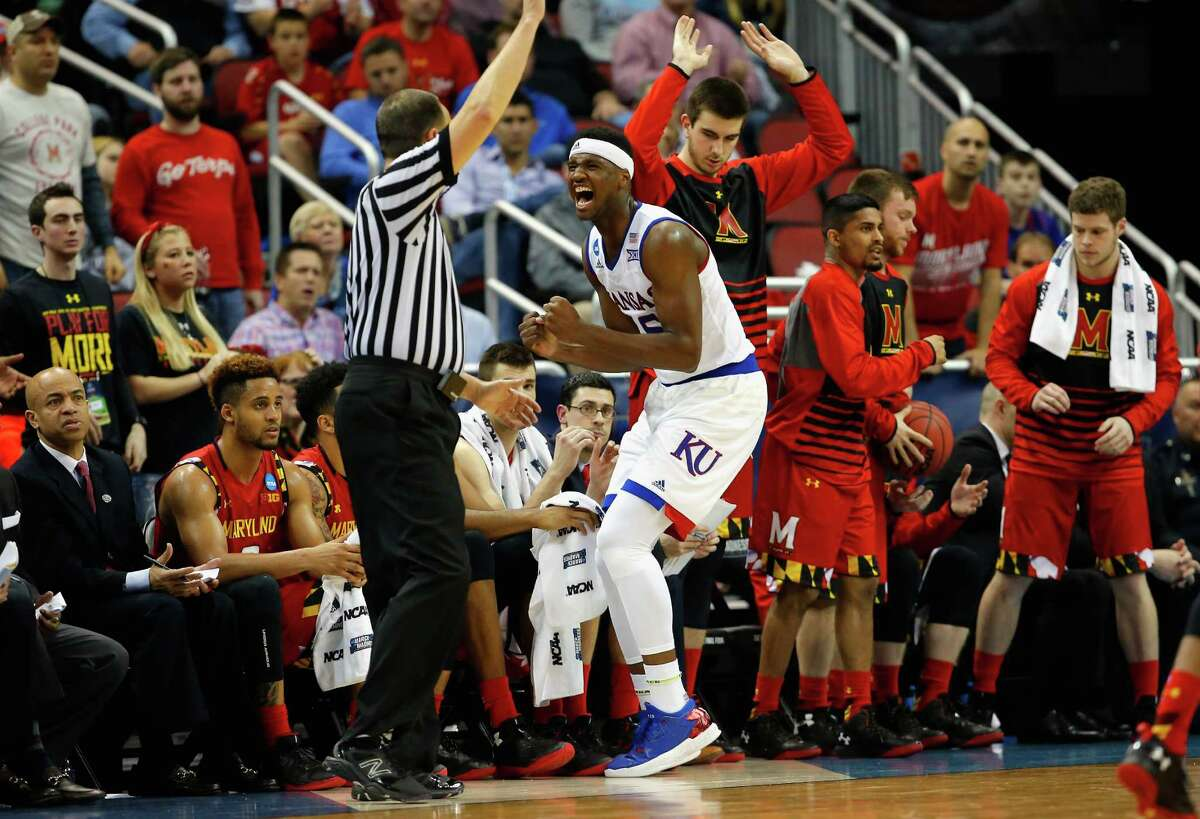 LOUISVILLE, KY - MARCH 24: Carlton Bragg Jr. #15 of the Kansas Jayhawks reacts in the second half against the Maryland Terrapins during the third round of the 2016 NCAA Men's Basketball Tournament at KFC YUM! Center on March 24, 2016 in Louisville, Kentucky.