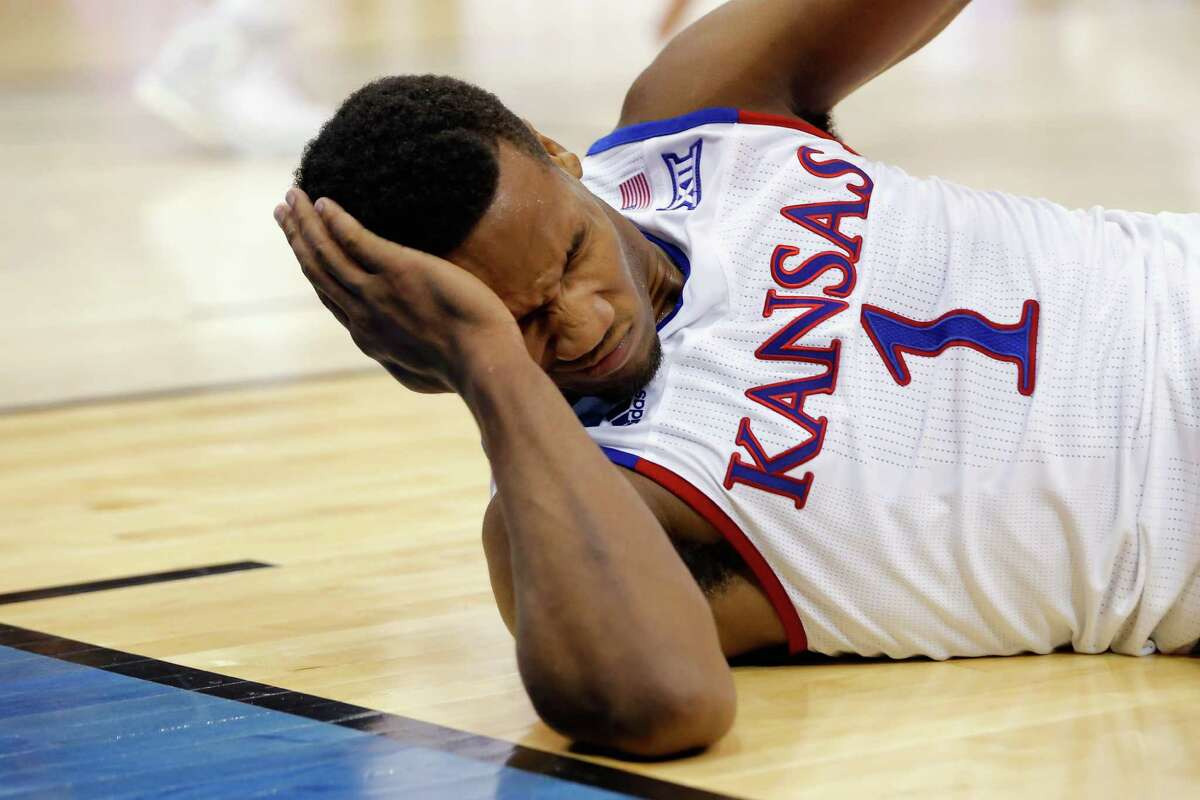 LOUISVILLE, KY - MARCH 24: Wayne Selden Jr. #1 of the Kansas Jayhawks reacts after slipping in the second half against the Maryland Terrapins during the third round of the 2016 NCAA Men's Basketball Tournament at KFC YUM! Center on March 24, 2016 in Louisville, Kentucky.