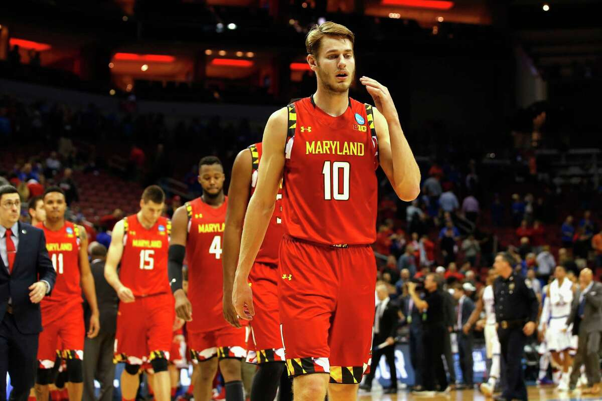 LOUISVILLE, KY - MARCH 24: Jake Layman #10 of the Maryland Terrapins reacts after being defeated by the Kansas Jayhawks 79-63 during the third round of the 2016 NCAA Men's Basketball Tournament at KFC YUM! Center on March 24, 2016 in Louisville, Kentucky.